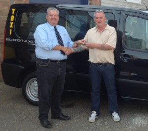 Mr Keenaghan collects the keys to his first EuroTaxi back in 2013.